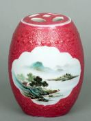 A Chinese jar and cover The pierced lid above the main pink ground body with twin scenic
