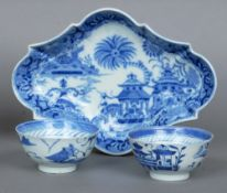 A pair of 19th century Chinese tea bowls Each decorated with pagodas amongst a landscape; together