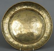 A 17th/18th century brass alms dish The broad border with lappet decoration, the domed central