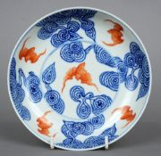 A Chinese porcelain dish Decorated with bats within stylised clouds, blue painted six character