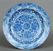 A Chinese porcelain charger, 18th century Decorated with floral sprays within a vignette border
