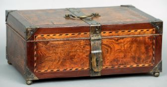A 19th century elm and mahogany box Of hinged rectangular construction with brass strapwork and