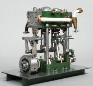 An exhibition quality Scratch built two stage vertical steam engine Housed in a wooden carrying