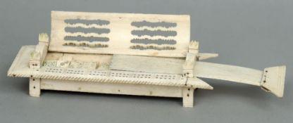 A Napoleonic War bone prisoner-of-war dominoes box The pierced carved hinged domed lid above a slide