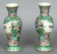 A pair of 19th century Chinese famille verte baluster vases Each decorated with figures in gardens.