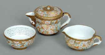 A late 19th century Japanese Satsuma three piece tea set Comprising: teapot and cover, a milk jug