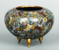 A 19th century Chinese cloisonne bowl With allover floral decoration, standing on three gilt