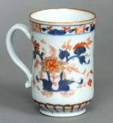 A late 18th/early 19th century Japanese Imari mug The waisted cylindrical body decorated with gilt