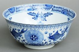 A 19th century Chinese blue and white bowl Decorated inside and out with various fish and floral