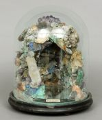 A Victorian mineral specimen grotto model Presented under a glass dome above a mirrored base with