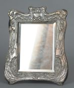 An Art Nouveau unmarked silver framed dressing table mirror With organic embossed decoration, the