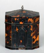 An early 19th century pressed tortoiseshell tea caddy Decorated with panels of Gothic