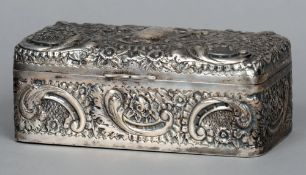 A Victorian embossed silver cigarette box, hallmarked Sheffield 1897, maker's mark of Mappin &
