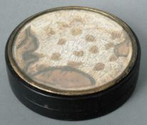 A 19th century French tortoiseshell snuff box Of circular form, the lid inset with a map of