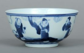 A Chinese porcelain blue and white bowl The exterior decorated with three figures in a landscape.