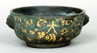 An archaistic style Chinese bronze censor The round body with mask head handles and gold splash