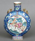 A 19th century Chinese moon flask The lappet decorated  neck above twin pierced gilt decorated