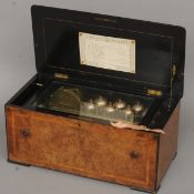 A 19th century Swiss walnut cased music box Playing eight airs, the line inlaid crossbanded and