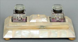 A Victorian mother-of-pearl desk stand The rectangular body with twin glass inkwells and a lidded