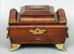 An early 19th century leather clad jewellery casket The hinged stepped domed lid centred with an