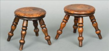 A pair of 19th century turned fruitwood miniature stools Each circular top above four turned legs.