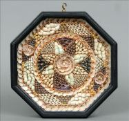 A 19th century sailor's shell valentine Housed in an octagonal ebonised frame with brass