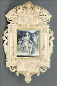 A fine quality 19th century Dieppe carved ivory frame The pediment carved with a crest flanked by