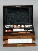 A 19th century rosewood artist's paint box The hinged rectangular lid inlaid with a mother-of-