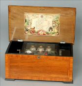 A 19th century walnut cased Swiss music box The crossbanded and ebonised hinged lid enclosing the