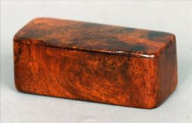 A 19th century burrwood snuff box Of plain rectangular form with hinged lid. 9.5 cms wide. Some