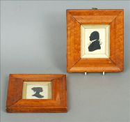 A pair of 19th century maple framed portrait silhouettes Of a gentleman and a young lady, framed and