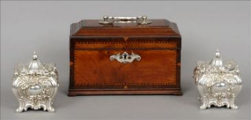 A 19th century mahogany tea caddy The hinged crossbanded domed rectangular lid with a loop handle