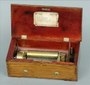 A small 19th century Swiss mahogany cased music box The line inlaid hinged rectangular top enclosing