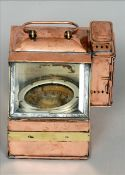 A portable copper cased gimbal mounted ships compass The side mounted with a burner, the interior