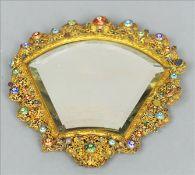 A 19th century enamel and semi-precious stone mounted gilt metal filigree mirror The ornate frame