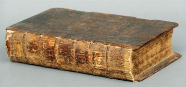 An early 18th century leather bound Prince James Bible Printed in 1708. 39.5 cms high. Leather cover