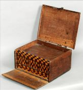 A 17th century boarded walnut desk box The hinged rectangular lid with iron strapwork above the fall