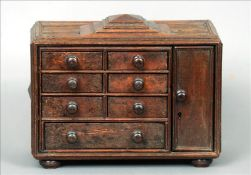 A small bank of late 19th century spice drawers The stepped and panelled rectangular top above an