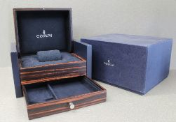 ONE LARGE CORUM WRIST WATCH / JEWELLERY BOX CIRCA 2000s With outer box, wooden leather case, felt