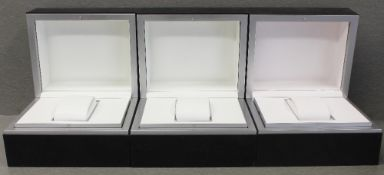 THREE IWC WRIST WATCH BOXES CIRCA 2000s Black boxes with white interiors and watch holders. No