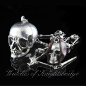 A PAIR OF RARE SOLID SILVER CASED POCKET WATCHES IN THE FORM OF A HUMAN SKULL WITH SKULL AND BONE