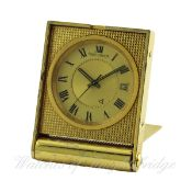 A GILT METAL JAEGER LECOULTRE ALARM TRAVEL CLOCK CIRCA 1970s D: Two piece champagne dial with