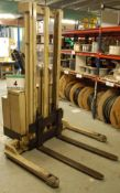 A CROWN '30 WTF' Pedestrian operated Battery Electric Stacker Truck with Duplex Mast & Mains