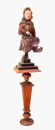 An 18th century Chinese God of War, depicted standing on one leg, carved wood polychrome painted,