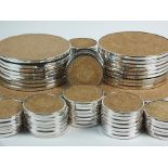 A collection of circular silver mounted cork drink, table and serving mats, JAG, London 1995 & 1996,