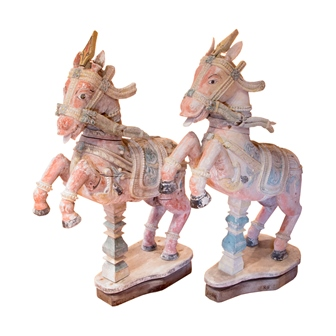 A pair of 19th century Indian carved wood rearing horses, polychrome painted on a white ground, with