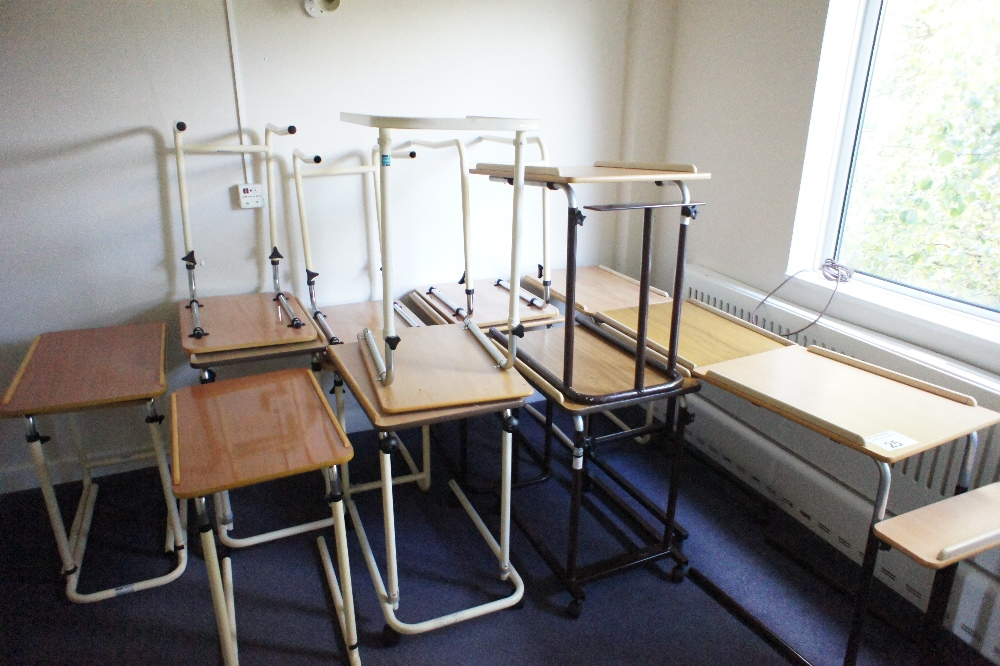Lot 25 - 16 miscellaneous adjustable bed tables (located in room 11, Davey Court)