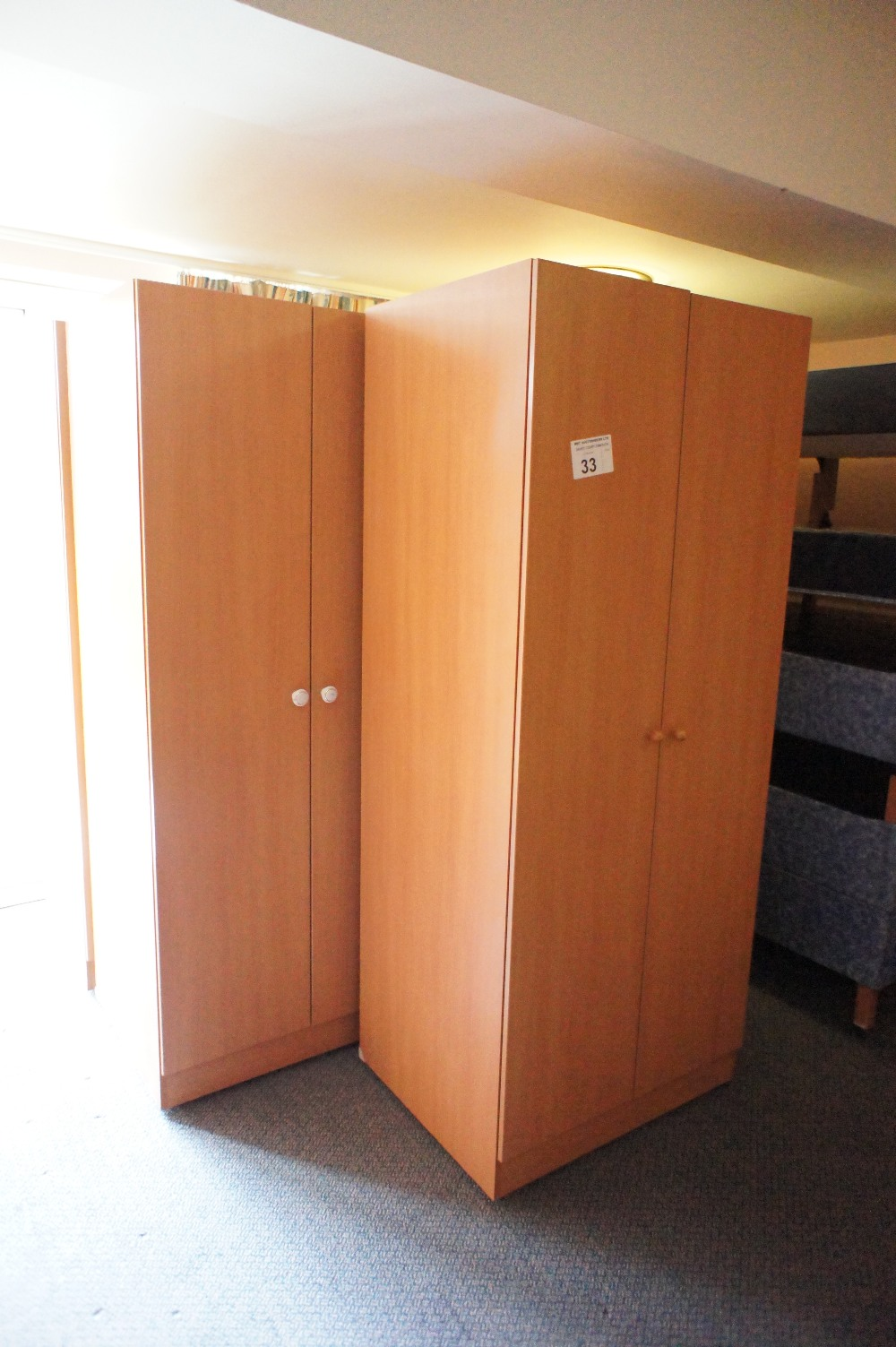 Lot 33 - 5 various woodgrained finished two door single wardrobes (located in room 16, Davey Court)