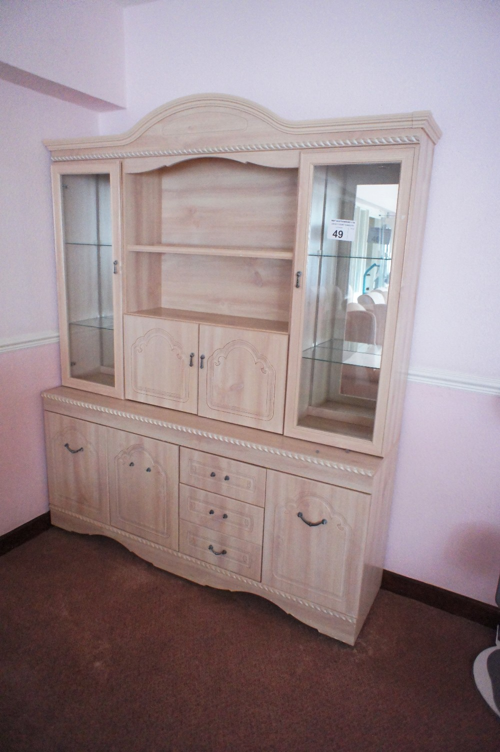 Lot 49 - 1 light colored woodgrained finished dresser with open shelves and cupboards (located in room 18,