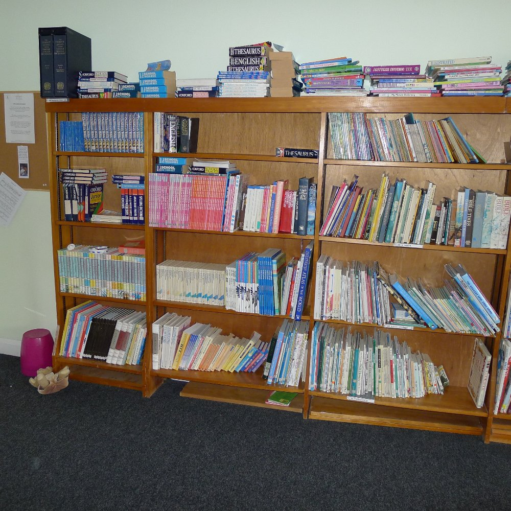 Lot 18 - Contents of junior library to include all books and book cases (located in junior school first